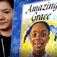 teacher showing the book amazing grace