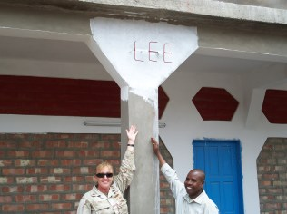 EOCS Leith and hostel staff posing with her last name on the new hotel