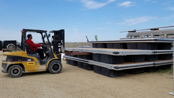 Loading L6 docks onto trailer for seasonal installation.