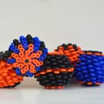 Five cora balls in black, blue and orange.