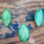 Shop: A green earring and necklace set made by Nurdle in the Rough.