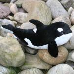 Shop: A cuddly black and white orca stuffed toy.