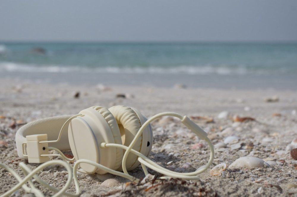 headphones beach ocean podcast
