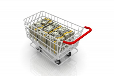 Shopping cart full of money. Generate more revenue with these ecommerce tips from Seafoam Media