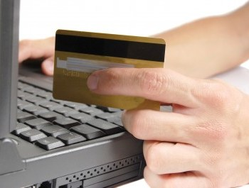 Person using laptop and credit card. 3 tricks for getting more online conversions