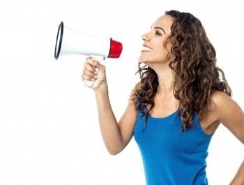 Woman with megaphone. Influencer marketing Seafoam Media blog