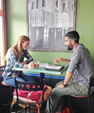 two people working together at a cafe table
