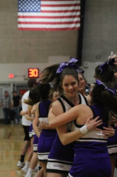 "Serena Rivas and Jordyn Vaughn ""squeeze"" one another in a fun cheer, taking a break from the game."