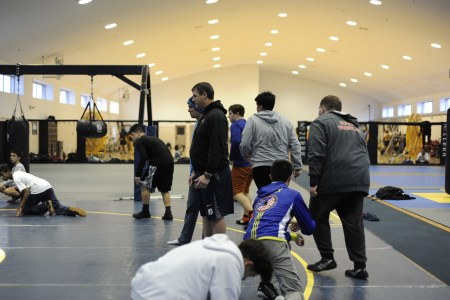 YOKOSUKA, Japan (Jan. 31, 2017) – Fleet Activities (FLEACT) Yokosuka's Nile C. Kinnick High School wrestling team prepares for the Japan Finals, the last home event for the Red Devils scheduled for 9 a.m. Saturday, Feb. 4. FLEACT Yokosuka provides, maintains, and operates base facilities and services in support of 7th Fleet's forward-deployed naval forces, 83 tenant commands, and 24,000 military and civilian personnel. (Photo by Kristina Mullis/170131-N-LV456-008 Released by FLEACT Yokosuka Public Affairs Office)