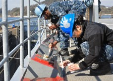 170222-N-YG414-033 YOKOSUKA, Japan (Feb. 22, 2017) - Seaman Nathaniel Smith, left, and Seaman Karina Ibarra Martinez, both attached to the U.S. 7th Fleet flagship USS Blue Ridge (LCC 19), paint areas of the ship's main deck. Blue Ridge is in an extensive maintenance period in order to modernize the ship to continue to serve as a robust communications platform in the U.S. 7th Fleet area of operations. (U.S. Navy photo by Mass Communication Specialist Seaman Patrick Semales/ RELEASED)