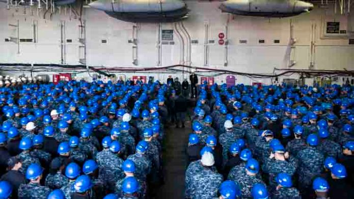 170407-N-AC117-134 YOKOSUKA, Japan (April 7, 2017) Adm. Scott H. Swift, Commander, U.S. Pacific Fleet, addresses Sailors' questions during an all-hands call in the hangar bay of the Navy's only forward-deployed aircraft carrier, USS Ronald Reagan (CVN 76). During the all-hands call, Swift presented the ship's crew with a Meritorious Unit Commendation award for their meritorious service during the period of January 2015 through December 2015. Ronald Reagan, the flagship of Carrier Strike Group 5, provides a combat-ready force that protects and defends the collective maritime interests of its allies and partners in the Indo-Asia-Pacific region. (U.S. Navy photo by Mass Communication Specialist 3rd Class MacAdam Kane Weissman/Released)