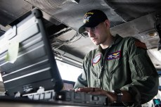 170507-N-WS952-083 YOKOSUKA, Japan (May 7, 2017) Lt. Jacob Weinzatl, prospective assistant navigator of Navy's forward-deployed aircraft carrier, USS Ronald Reagan (CVN 76), verifies the status of navigation equipment on the ship's navigation bridge. Ronald Reagan is conducting sea trials, a series of drills and evaluations, to verify the ship's readiness for its upcoming patrol. Ronald Reagan, the flagship of Carrier Strike Group 5, provides a combat-ready force that protects and defends the collective maritime interests of its allies and partners in the Indo-Asia-Pacific region. (U.S. Navy photo by Mass Communication Specialist 2nd Class Brandon Martin/Released)