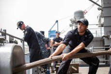 170507-N-WZ681-255 WATERS EAST OF JAPAN (May 7, 2017) Boatswain's Mate Petty Officer 3rd Class (SW) Preston Suggs, from Kinston, North Carolina, hauls in mooring lines on the fantail of the Navy's forward-deployed aircraft carrier, USS Ronald Reagan (CVN 76). Ronald Reagan is conducting sea trials, a series of drills and evaluations, to verify the ship's readiness for its upcoming patrol. Ronald Reagan, the flagship of Carrier Strike Group 5, provides a combat-ready force that protects and defends the collective maritime interests of its allies and partners in the Indo-Asia-Pacific region. (U.S. Navy photo by Mass Communication Specialist Seaman Apprentice Randy Lee Adams II/Released)