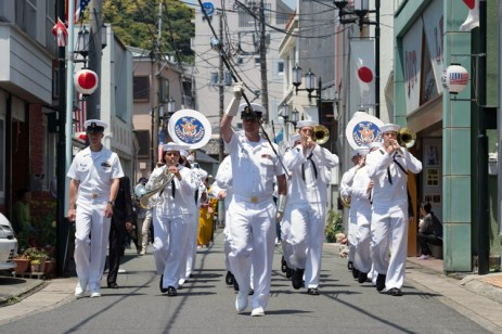 170521-N-NT265-073 SHIMODA, Japan (May 21, 2017) – The U.S. 7th Fleet Band performs during a parade down the main street of Shimoda, Japan, as part of the Shimoda Black Ship Festival. The Navy's participation in the festival celebrates the heritage of U.S.-Japanese naval partnership first established by commodore Matthew Perry's 1853 port visit. For more than 160 years, the United States has established a heritage of naval presence in the Indo-Asia-Pacific region to promote partnership, prosperity, and maritime security. (U.S. Navy photo by Mass Communication Specialist 2nd Class Christian Senyk/Released)