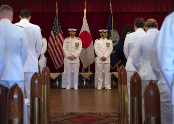 170607-N-HE318-092 YOKOSUKA, Japan (June 7, 2017) Rear Adm. John G. Hannink, Commander, Naval Legal Services Command (NLSC), left, and Capt. David Harrison, incoming commanding officer, Defense Service Office Pacific (DSO) Pacific, bow in prayer during a change of command ceremony at Fleet Activities (FLEACT) Yokosuka Officer's Club. Attorneys with DSO provide legal representation and advice to military service members on defense-related topics. (U.S. Navy photo by Mass Communication Specialist 2nd Class William McCann/Released)