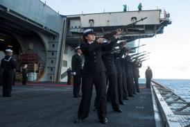 """170715-N-OY799-096 CORAL SEA (July 15, 2017) The firing detail renders a 21-gun salute during a burial-at-sea ceremony for Julius """"Harry"""" Frey and his wife, Jerry, aboard the Navy's forward-deployed aircraft carrier, USS Ronald Reagan (CVN 76), during Talisman Saber 2017. Frey, a WWII veteran, served aboard USS Lexington (CV 2) during the Battle of Coral Sea and his ashes were laid to rest at the coordinates where the ship sank. Talisman Saber is a realistic and challenging exercise that brings service members closer and improves both U.S. and Australia's ability to work bilaterally and multilaterally, and prepares them to be poised to provide security regionally and globally. (U.S. Navy photo by Mass Communication Specialist 2nd Class Kenneth Abbate/Released)"""