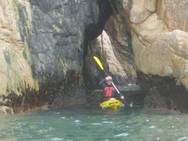 Paddling through a sea cave