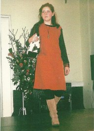 Emily Merron, UK, 2005 - Emily Merron feeling nervous on her first (and last !) catwalk, modelling a contemporary winter shift dress for a charity fashion show 10 years ago when she was 15.