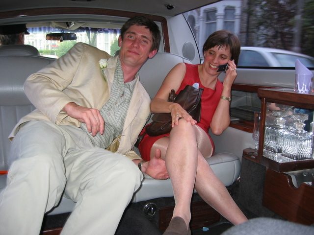 Maudie Smith, 2002, UK - This is me just after getting married in 2002. The dress wasn't new but it is my favourite colour and was so easy for a busy mum to fling on before the Registry Office - you can't see the baby and the toddler in the other side of the limo!