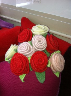 Felted wool rose brooches at the FFCC 2014