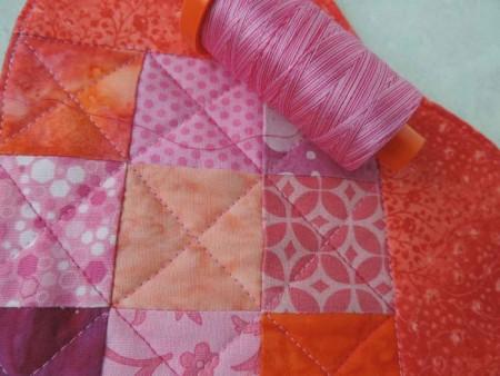 red and pink mug rug