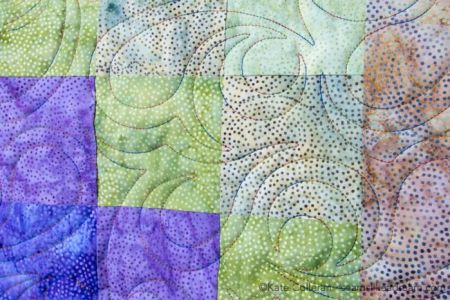 Island Batik Four Seasons Quilt Pattern featured by top US quilting blog and shop, Seams Like a Dream Quilt Designs: swirly quilting design
