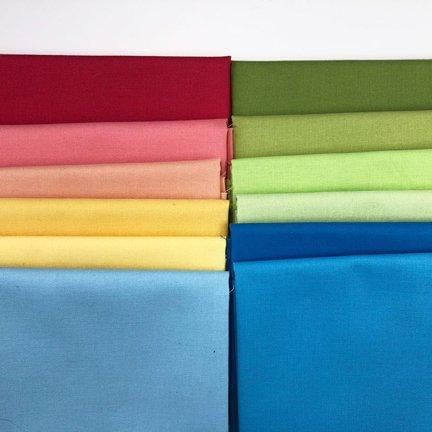 Solid fabrics for block 1 of Adventure Quilt
