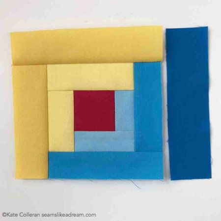 The Adventure Quilt ... a Road Trip Quilt Along Project, featured by top US quilting blog and shop, Seams Like a Dream Quilt Designs: building a yellow and blue log cabin block