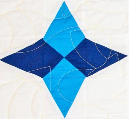 Block 9 Star of the Adventure Quilt in medium blue and dark blue