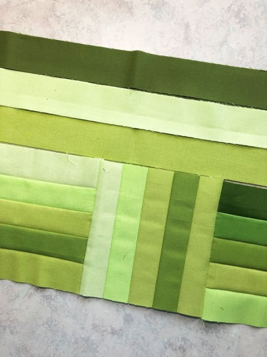 Strips made into small blocks for a runner with green strips auditioning for the borders.