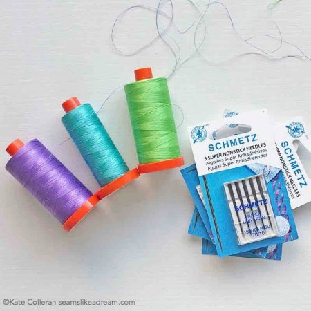 The Ultimate Guide to the Different Sewing Machine Needles featured by top quilting and sewing shop, Seams Like a Dream Quilt Designs, explains how to pick the best needle to use for your next sewing project.