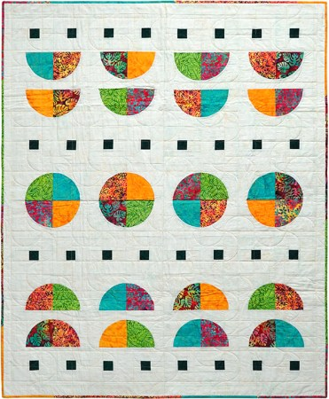 A New Quilt Pattern featured by top US quilting blog and shop Seams Like a Dream Quilt Designs, reveals their modern Drunkard's Path quilt Tropical Moon!