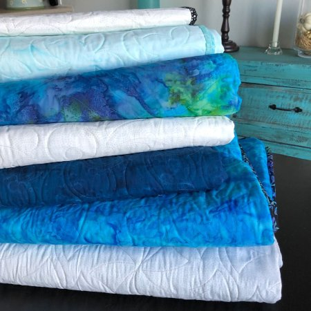 A Quilt Tutorial featured by top US quilting blog and shop Seams Like a Dream Quilt Designs, talks about making quilts.
