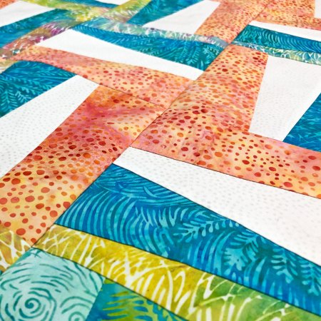 Top US quilting blog and shop, Seams Like a Dream Quilt Designs, shares about a re-imagined Rail Fence quilt!