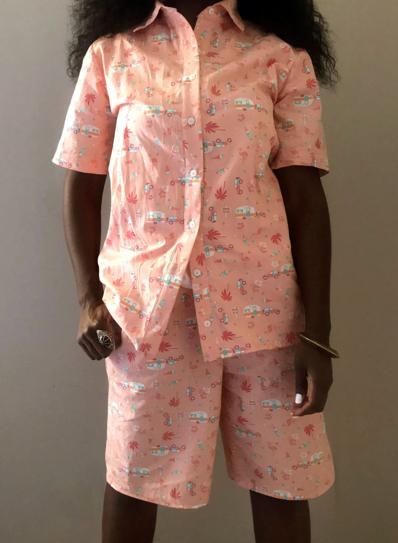 Front view of coral colored matching shirt and short set