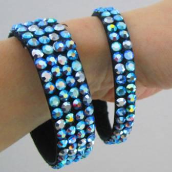 rhinestones, rhinestone bracelets, rhinestone earrings, rhinestone hairpiece, rhinestoned Dancesport jewelry, rhinestone skate dress