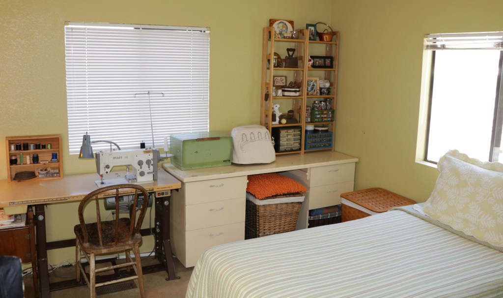 home sewing room that doubles as a guest bedroom