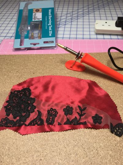 black lace and red satin backing for cutting out lace motifs