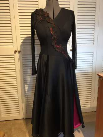 ballroom dress in progress with lace appliques and a slit skirt