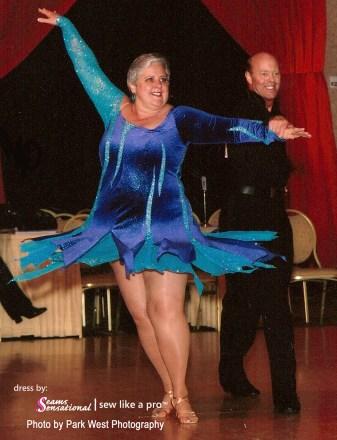 julie vincent wearing a purple velvet Latin dress