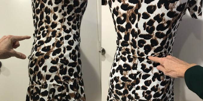 carol points to wrinkles in back panel of practicewear dress