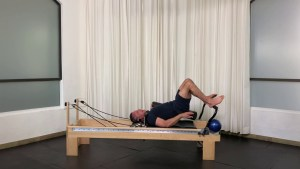 Lumbar traction with ball and roller _progressive Pilates Workshop