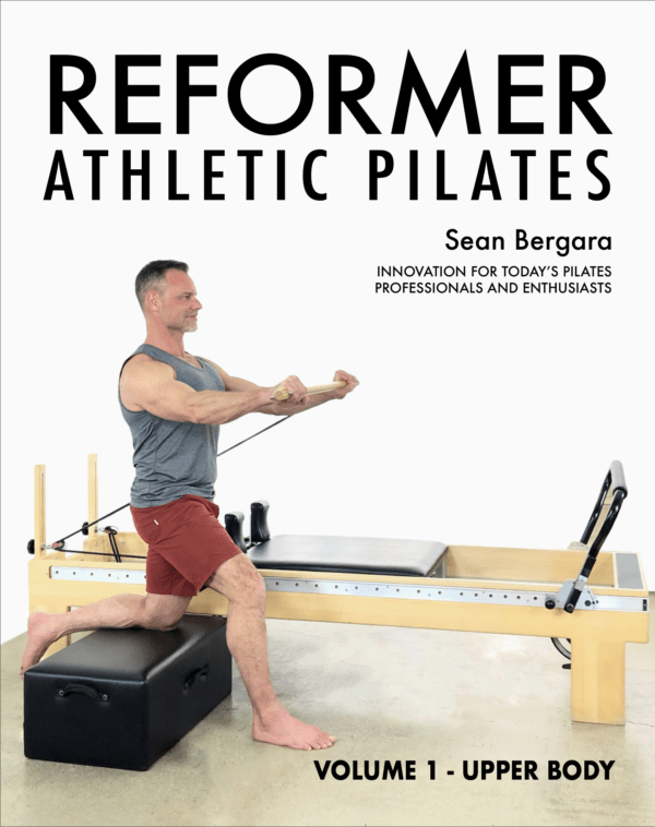 Reformer Athlestic Pilates Cover - Sean Bergara is using a pilates machine, and is in a lunge, using a block to help support the pose