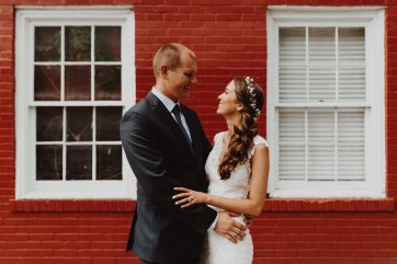 Bride and Groom embrace in front of Downtown Portland Oregon Wedding Venue