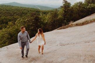 engaged couple walking through oregon