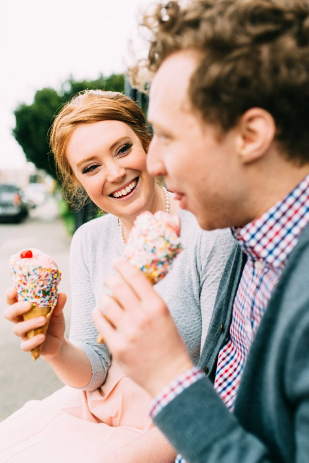 Couple eats ice cream during their fifties styled engagement shoot