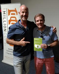 "Sean Donovan and Dr. Lou Paris pose with a copy of ""Konkeros 2018"""