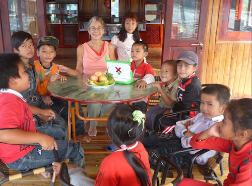 Nancie Severs with the kids in Vietnam and the XO.