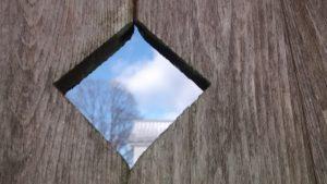 the sky through a diamond-shaped hole