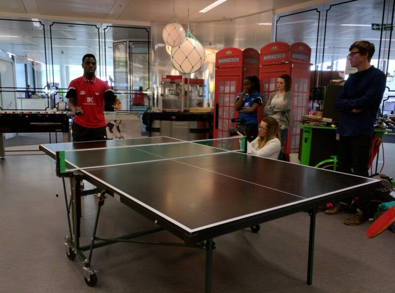 Darius Knight plays ping pong at Google London